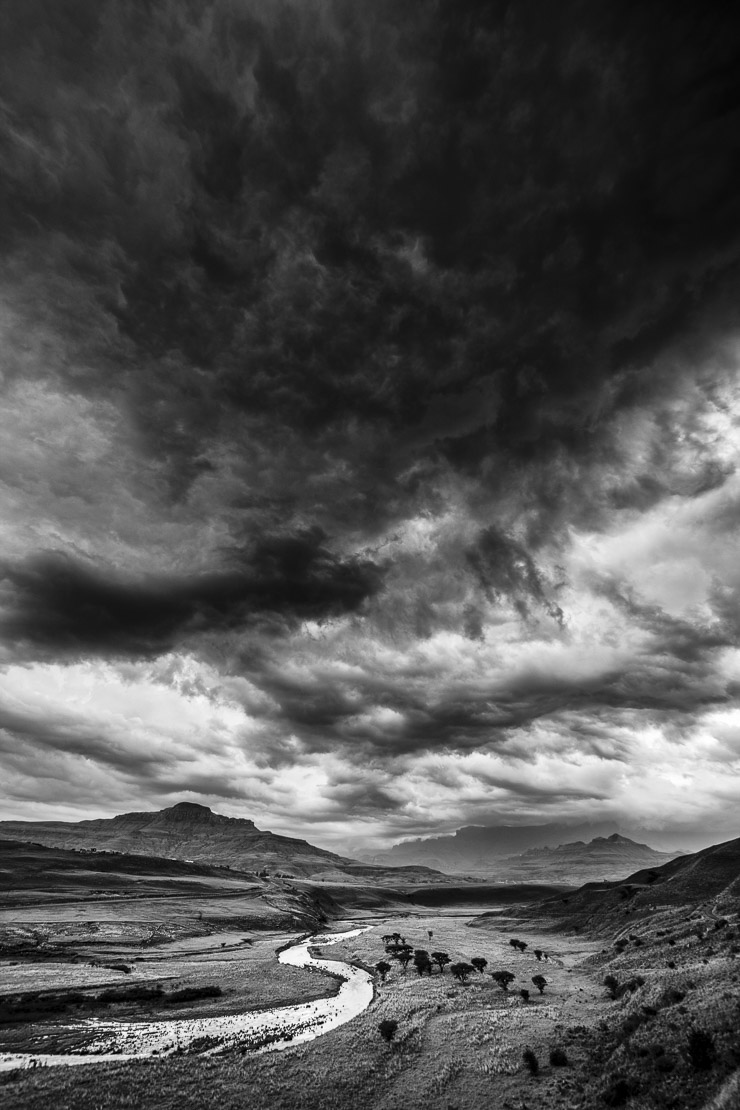 a moody evening sky over the Tugela Valley with the Drakensberg Mountains beyond, KwaZuluNatal, South Africa