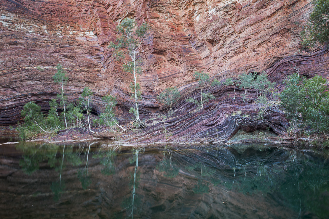 layers of twisted aincient rock in Hamersley Gorge, Karijini National Park, Pilbarra, Western Australia