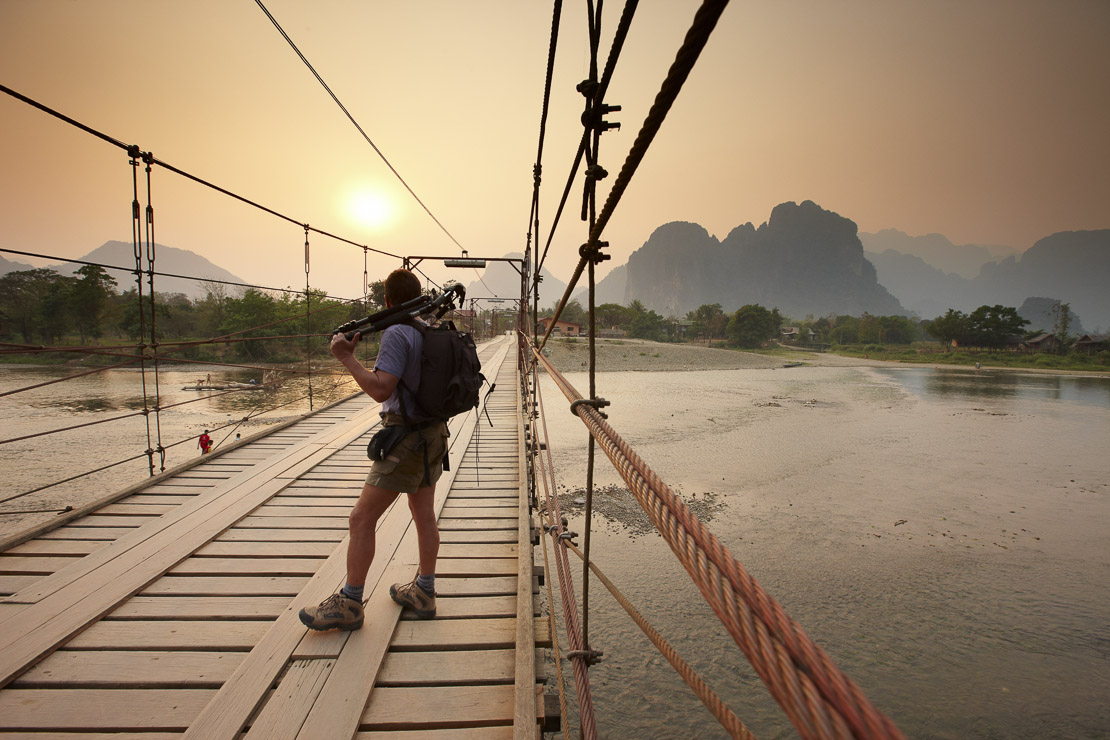 crossing the bridge over the Nam Song River at Vang Vieng, Laos