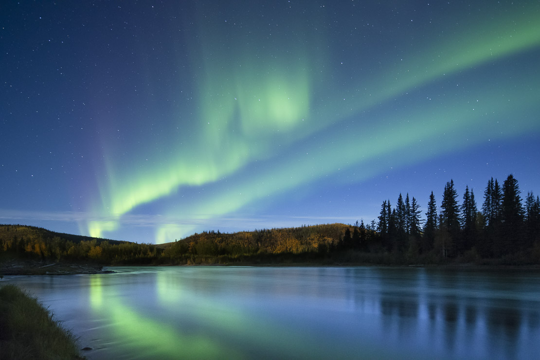 The Aurora Borealis (Northern Lights) over the Klondike River, Yukon Territories, Canada