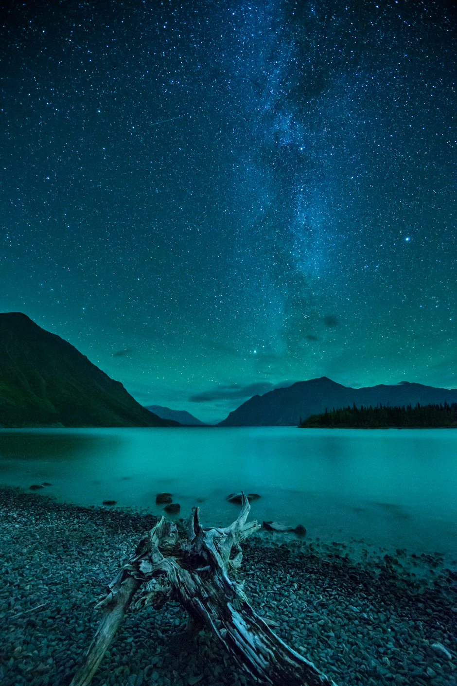 The Milky Way and night sky over Kathleen Lake and the St Elias Mountains, Kluane National Park, Yukon Territories, Canada