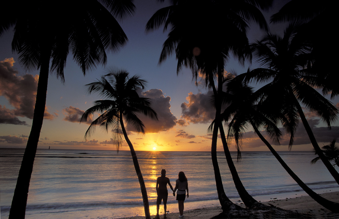 couple on beach at Sunset, Pigeon Point, Tobago