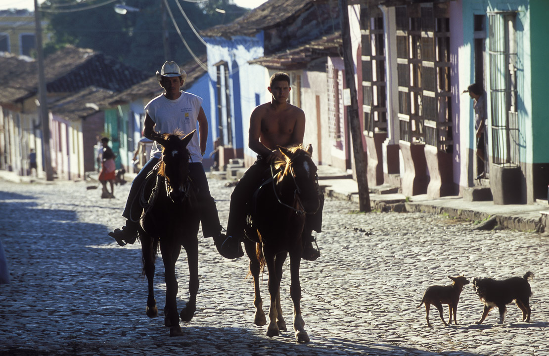 street scene with horse riders, Trinidad, Cuba