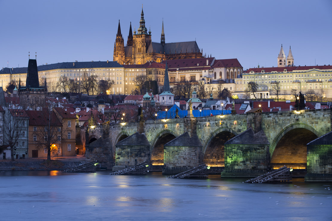 the Castle District, St Vitus Cathedral and the Charles Bridge over the River Vltava at dusk, Prague, Czech Republic