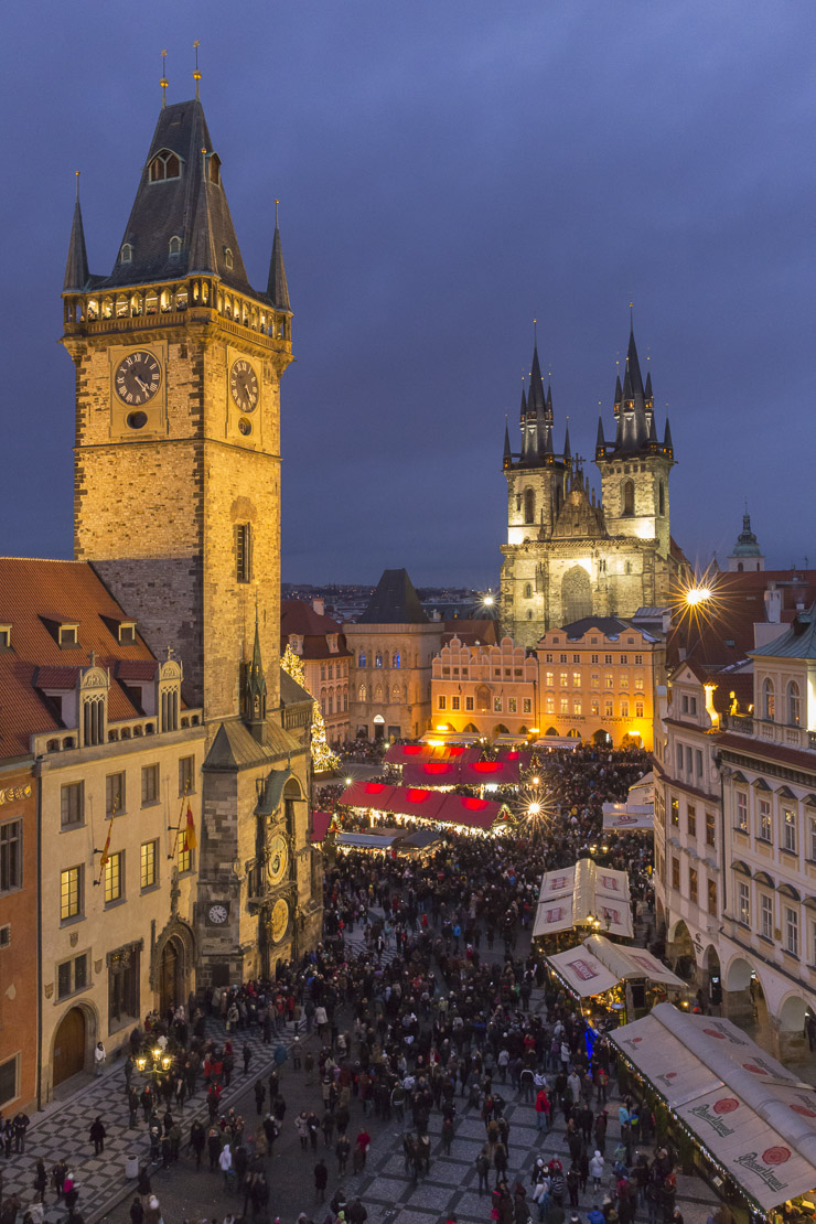 the Old Town Square at dusk, with the Old Town Hall and Church of Our Lady Before Tyn, Prague
