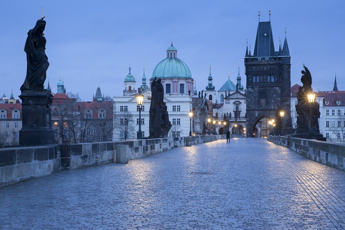 dawn on the Charles Bridge with the towers and spires of the Old Town beyond, Prague, Czech Republic