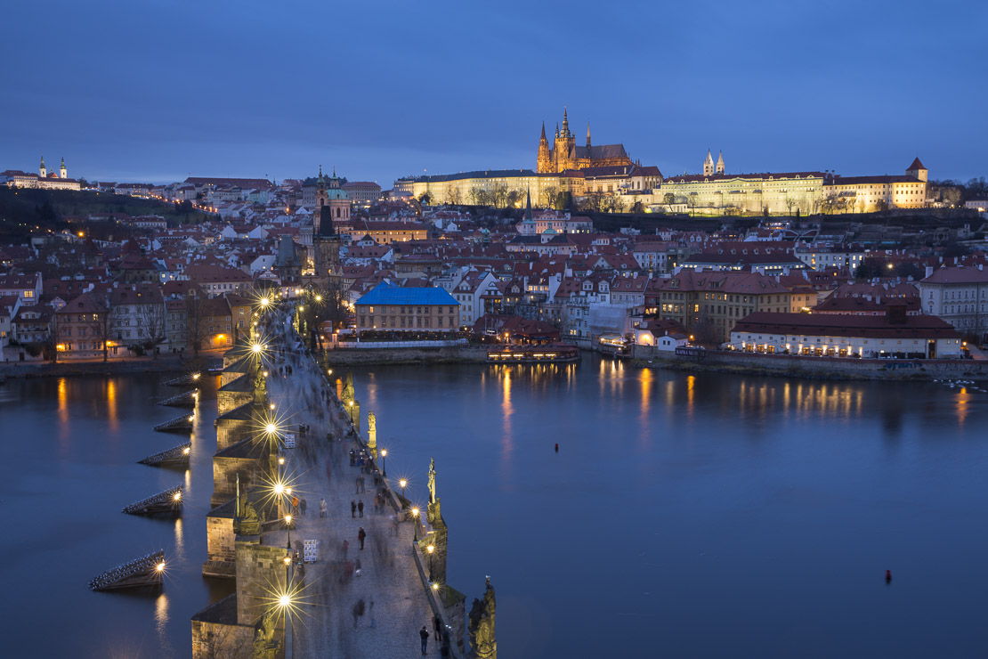 the, Charles Bridge over the Vltava River at dusk, with the Castle District and St Vitus's Cathedral beyond, Prague, Czech Republic