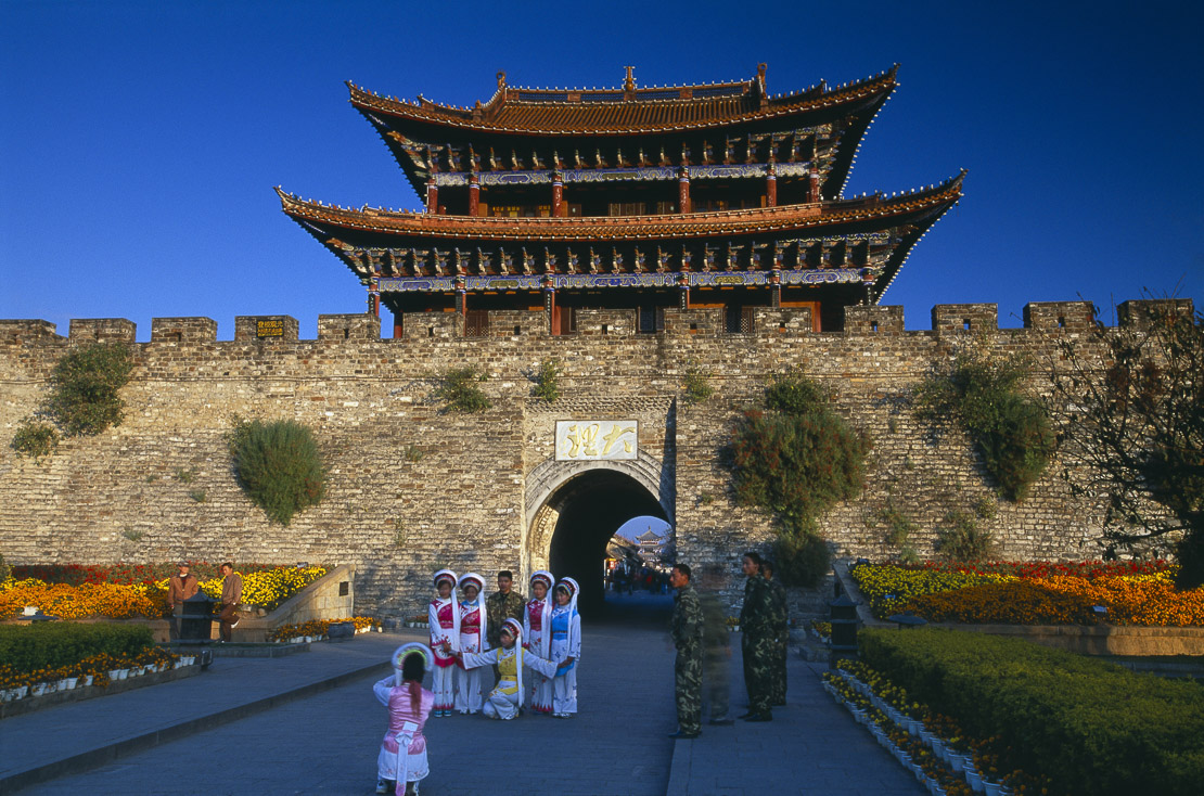 South gate with traditional Bai/ Chinese women and soldiers, Dali, Yunnan Province, China
