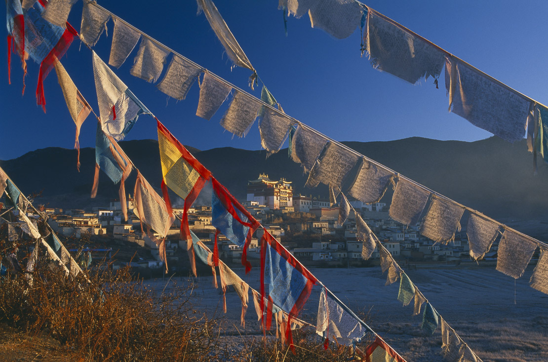 Jietang Songlin Monastery outside Zhongdian with prayer flags, Yunnan Province, China