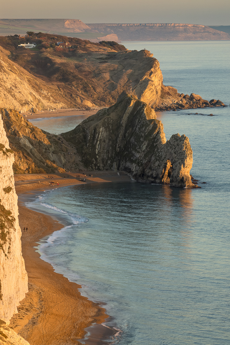 Durdle Door and St Oswald's Bay from Bat's Head at dusk, Purbeck, Jurassic Coast, Dorset, England, UK