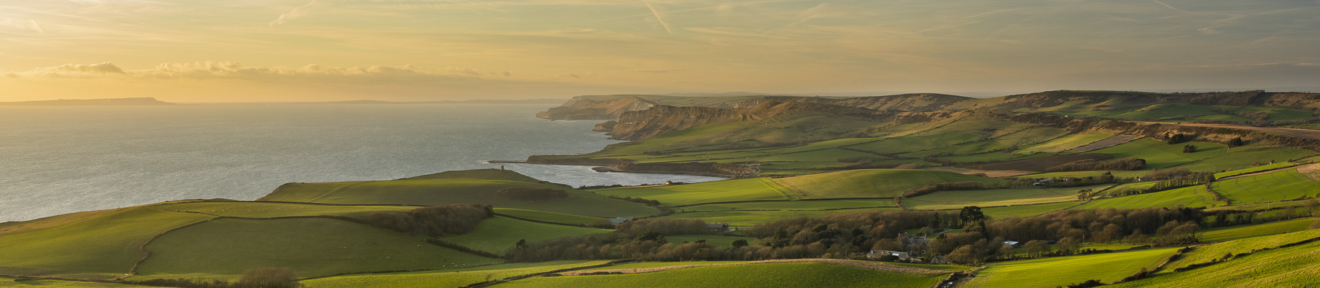 The Jurassic Coast with Portland, Clavell Tower and Kimmeridge Bay from Swyre Head, Purbeck, Dorset, England, UK