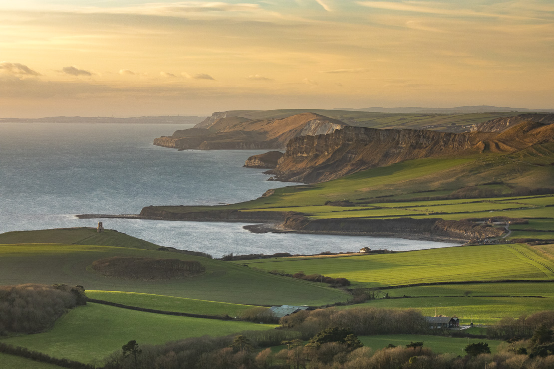 The Jurassic Coast with Clavell Tower and Kimmeridge Bay from Swyre Head, Purbeck, Dorset, England, UK
