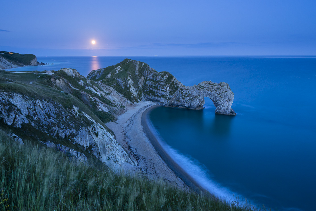 the supermoon rising over Durdle Door, Jurassic Coast, Dorset England