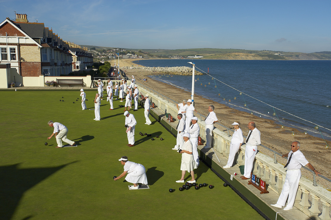 people playing bowls on the front, Weymouth, Dorset, England, UK