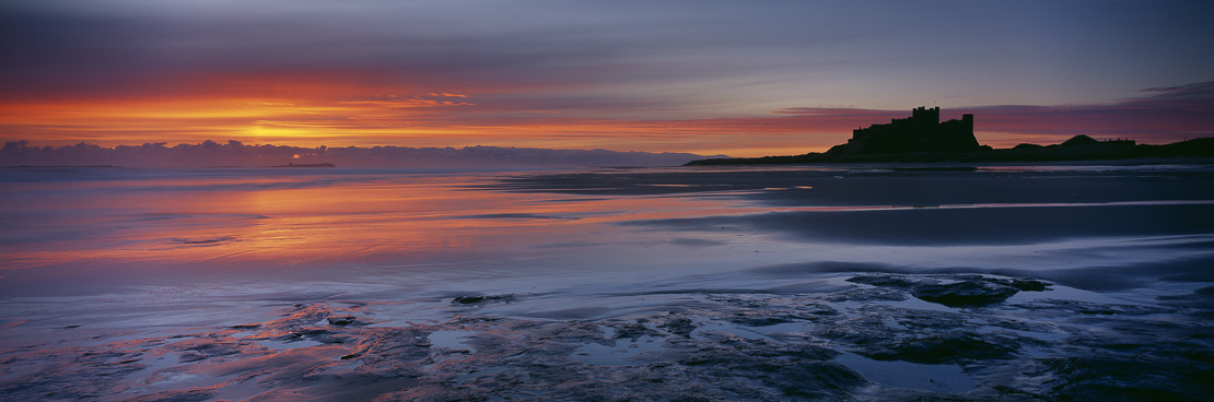 dawn on the beach at Bamburgh Castle, Northumbria, England, UK