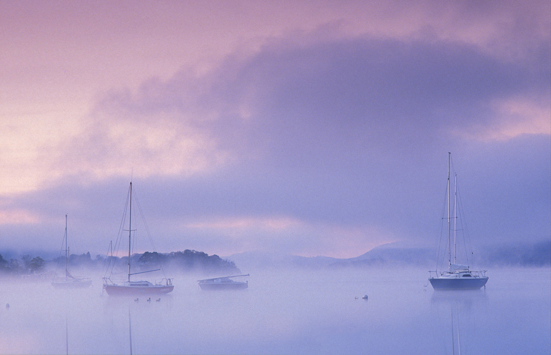 Boats on Windermere at dawn, Bowness-on-Windermere, Lake District National Park, Cumbria, England, UK