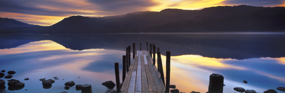 dawn on Derwentwater at Brandelhow Bay, Lake District National Park, Cumbria, England, UK