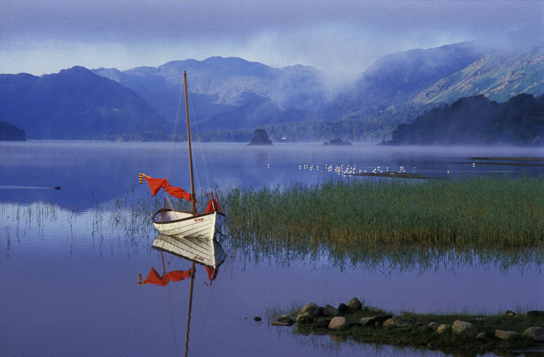 Redsail on Boat, Derwentwater, Lake District National Park, Cumbria, England, UK