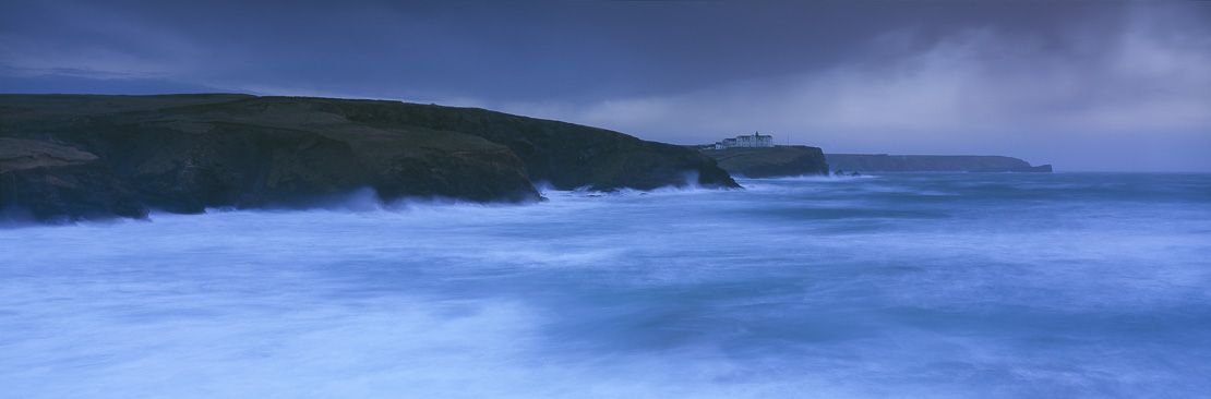 rough seas at Gunwalloe with Hotel on cliff tops, The Lizard, Cornwall, England, UK