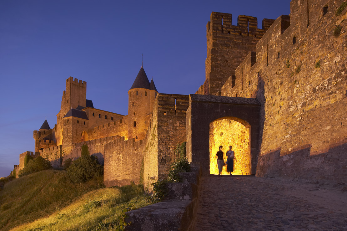 the ramparts of the medieval Cite at dusk, Carcassonne, Languedoc, France