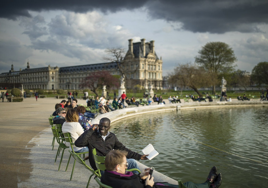 people relaxing on a spring evening in the Jardins des Tuileries, Paris, France