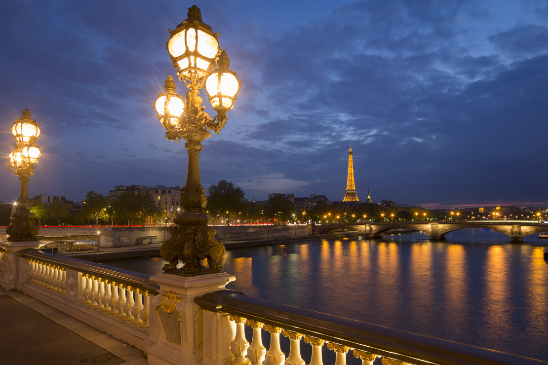 Pont Alexandre III, looking toward the Eiffel Tower over the River Seine at dusk, Paris, France