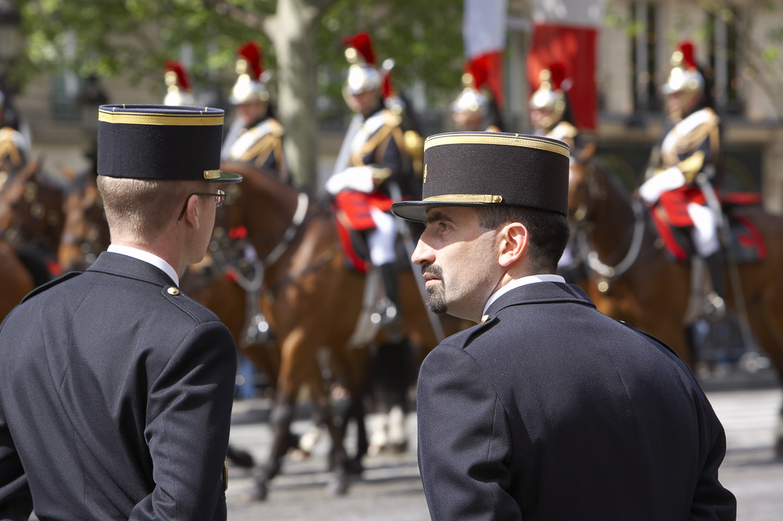 gendarmes (police) & French Cavalry (Presidential escort) on the Champs Elysses, Paris, France