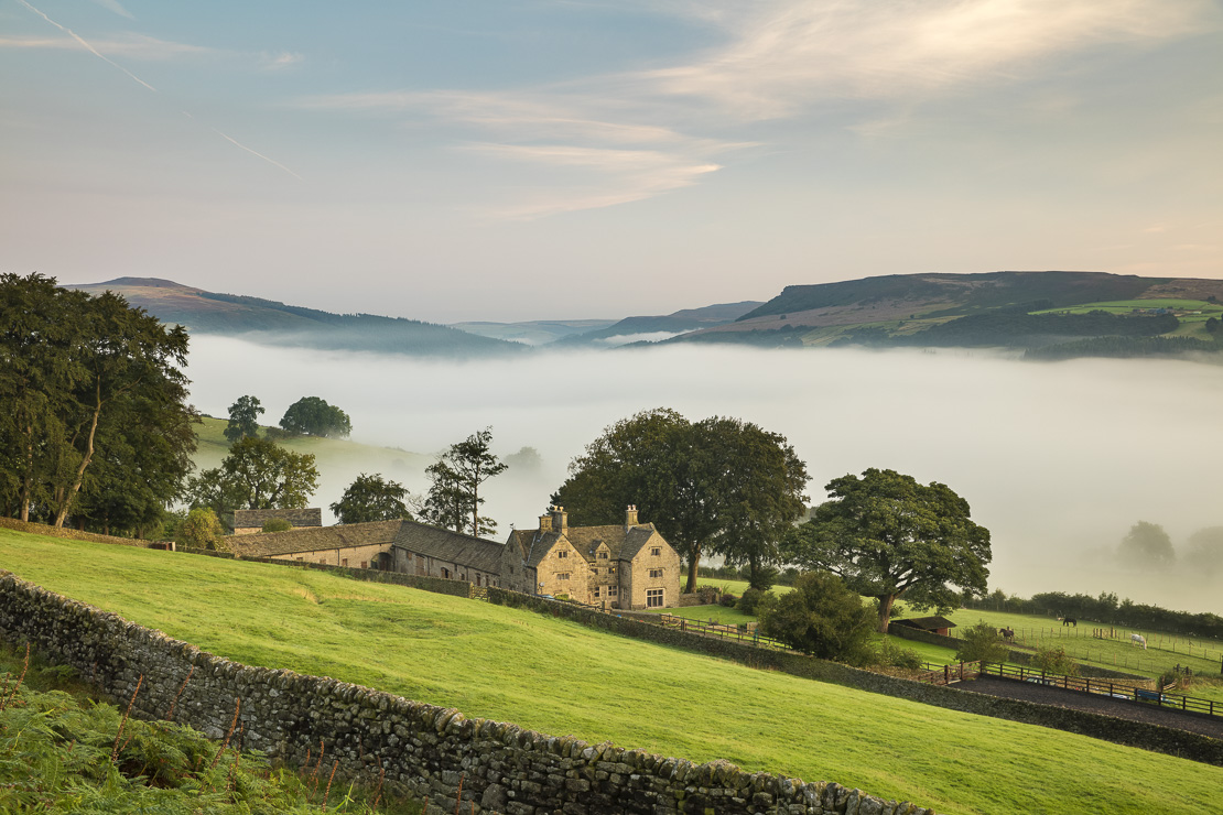 Offerton Hall above the mist in the Derwent Valley below, Derbyshire Peaks District, England, UK