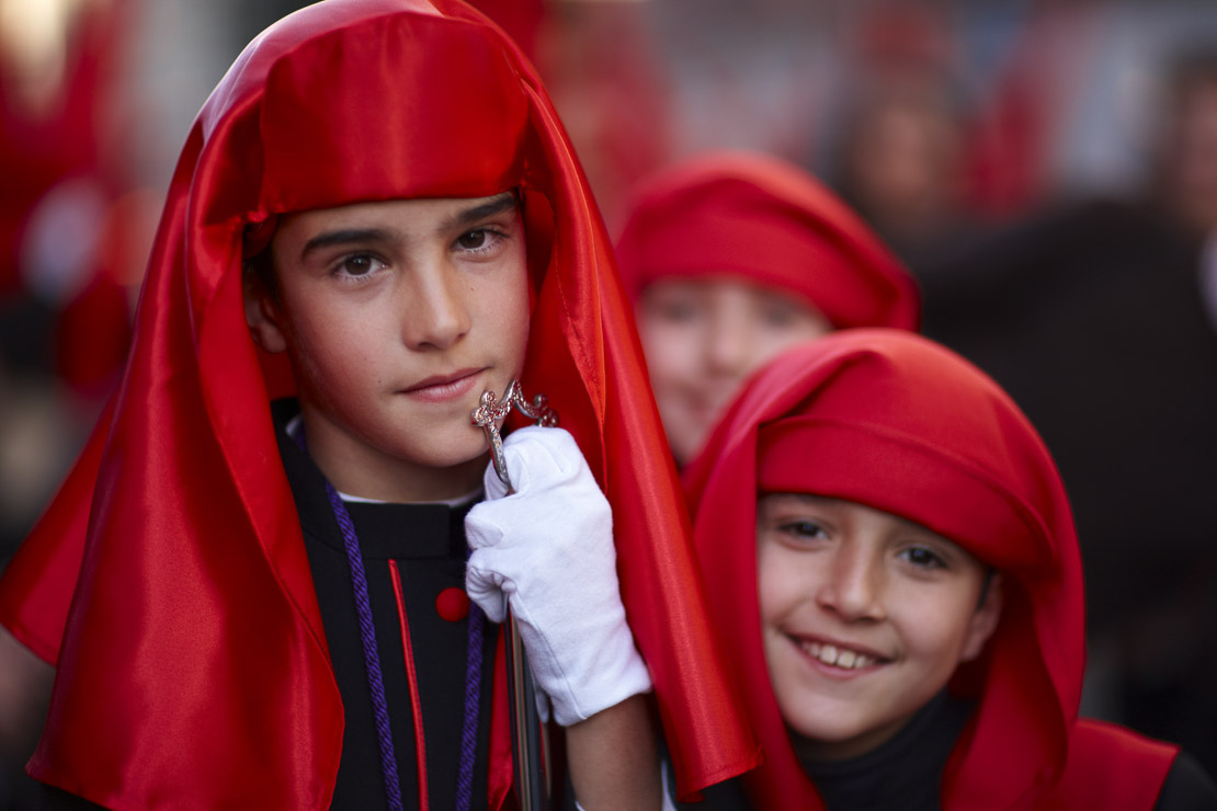 children in the Semana Santa processions in Malaga, Andalucia, Spain