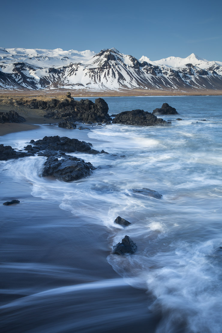 the coast at Budir with the mountains of Holsfjall and the Snaefellsnes Peninsula, Western Iceland