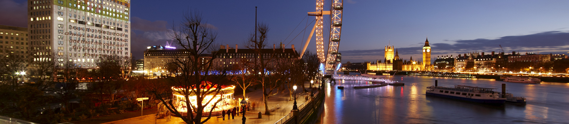 the Embankment (South Bank) with the London Eye, River Thames and the Palace of Westminster at dusk, London, England, UK
