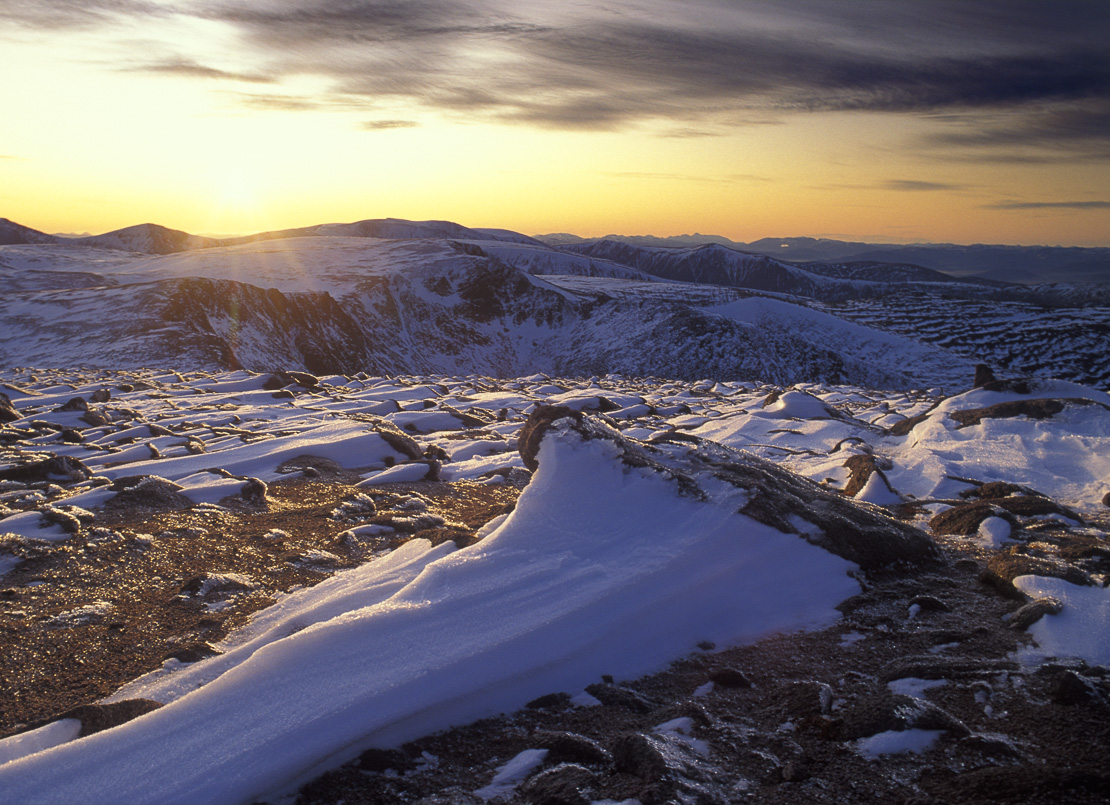 the sumiit of Cairn Gorm in winter at dusk, Cairngorms, Scotland, UK