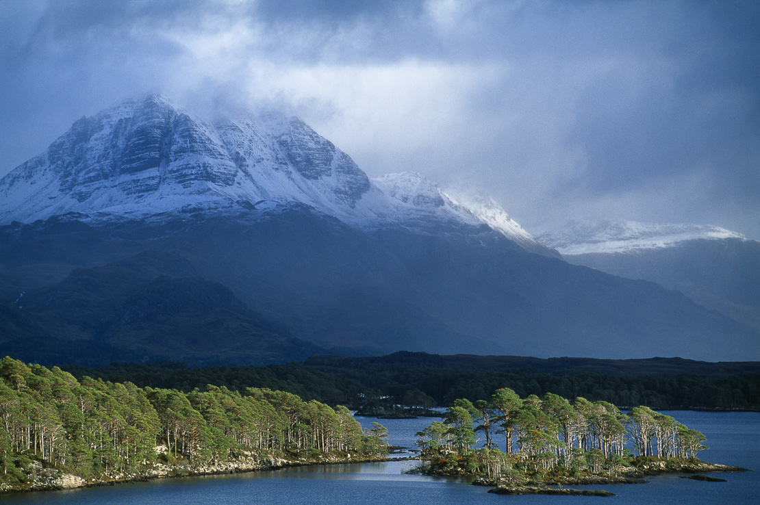 a snow capped Slioch rising above Loch Maree, Wester Ross, Scotland, UK