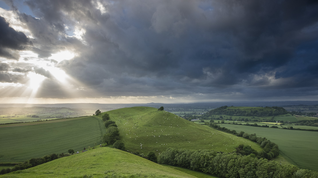 crepuscular rays over Parrock Hill and Glastonbury, Somerset, England