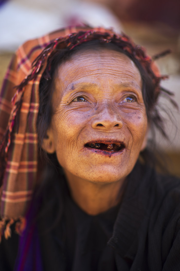 a lady with teeth blackened by chewing beetle nuts in the market at Nyaungshwe, on Inle Lake, Myanmar (Burma)