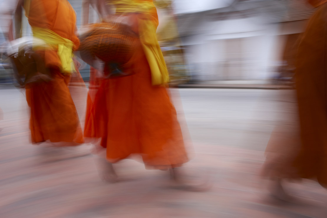 the procession of monks at dawn through the town to collect gifts of food, Luang Prabang, Laos