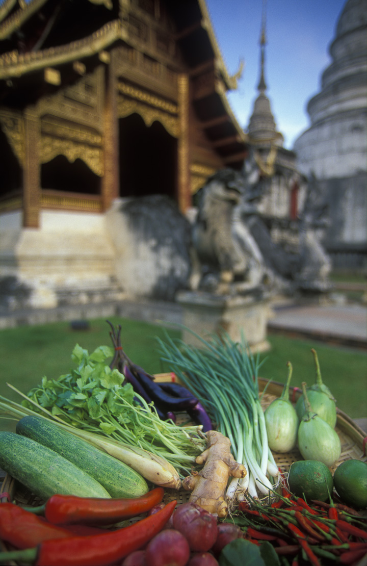 Wat Phra Singh with platter of vegetables, Chiang Mai, Thailand