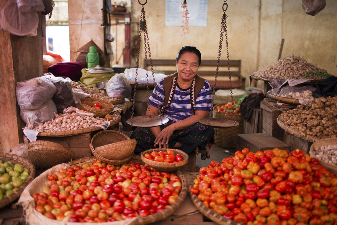 a woman selling tomatos in the market at Pyin Oo Lwin, Shan Highland, Myanmar (Burma)