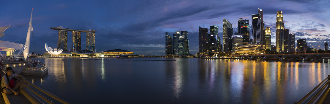 the skyline at night from the Esplanade with Marina Bay (left) and the Central Business District (right), Singapore