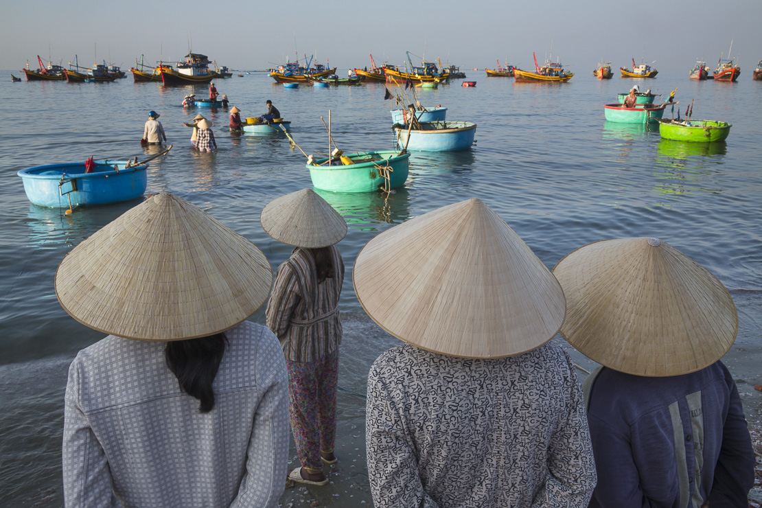 ladies awaiting the landing of the catch, Mui Ne fishing village, Bình Thuận Province, Vietnam
