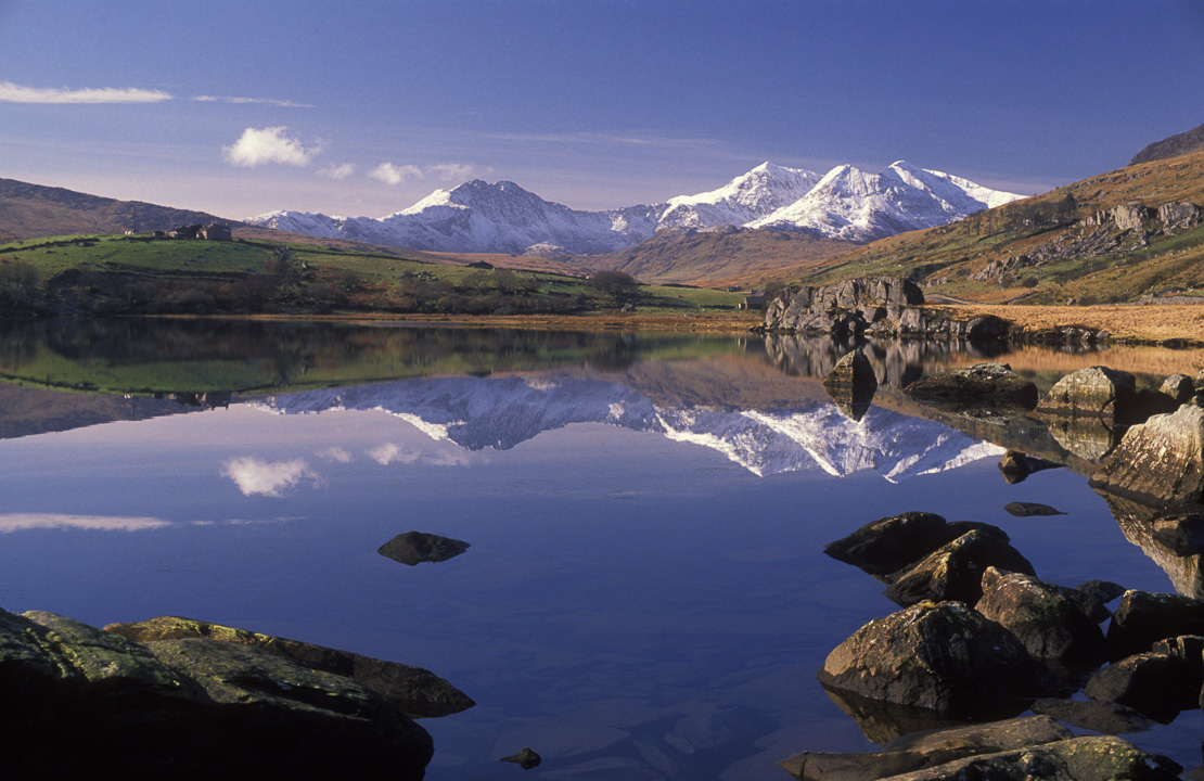 Mount Snowdon reflected in Llynnew Mymbyr, Nr Capel Curig, Snowdonia National Park, Wales, UK