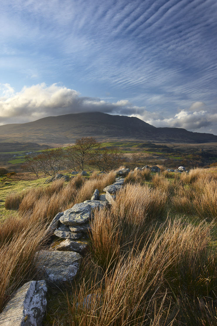 a stone wall above the Glyn Lledr near Dolwyddelan with Moel Siabod beyond, Snowdonia National Park, North Wales, UK